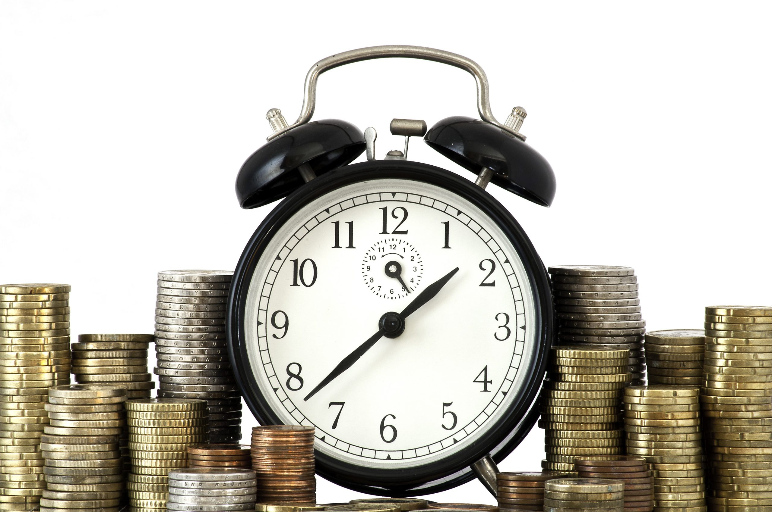 clock surrounded by money