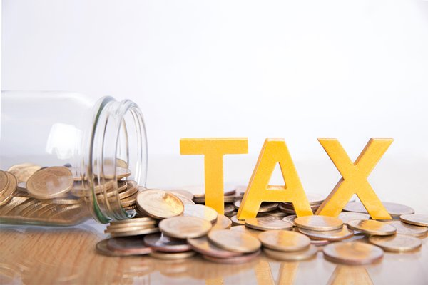 Money on table with tax information
