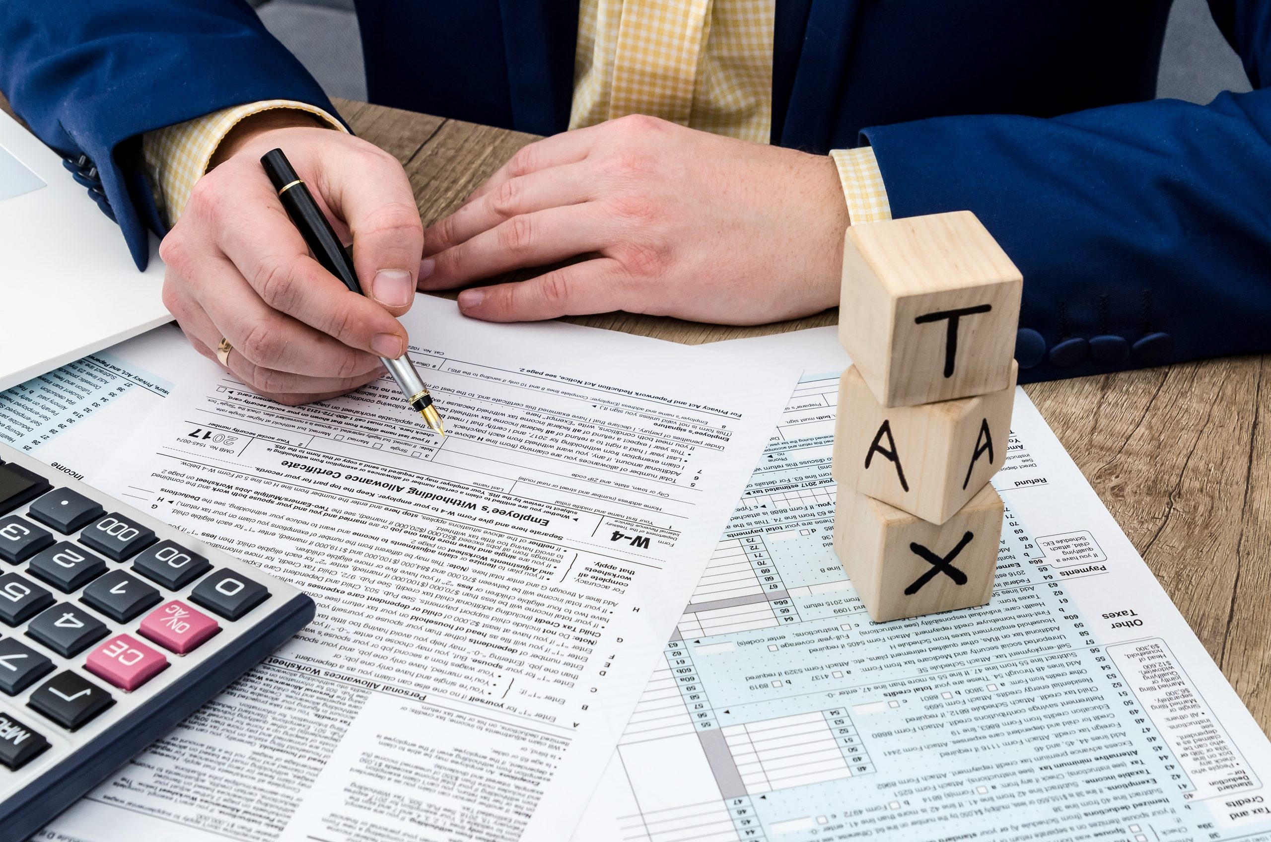 Business person filling out tax forms